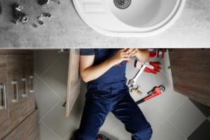 Man repairing sink